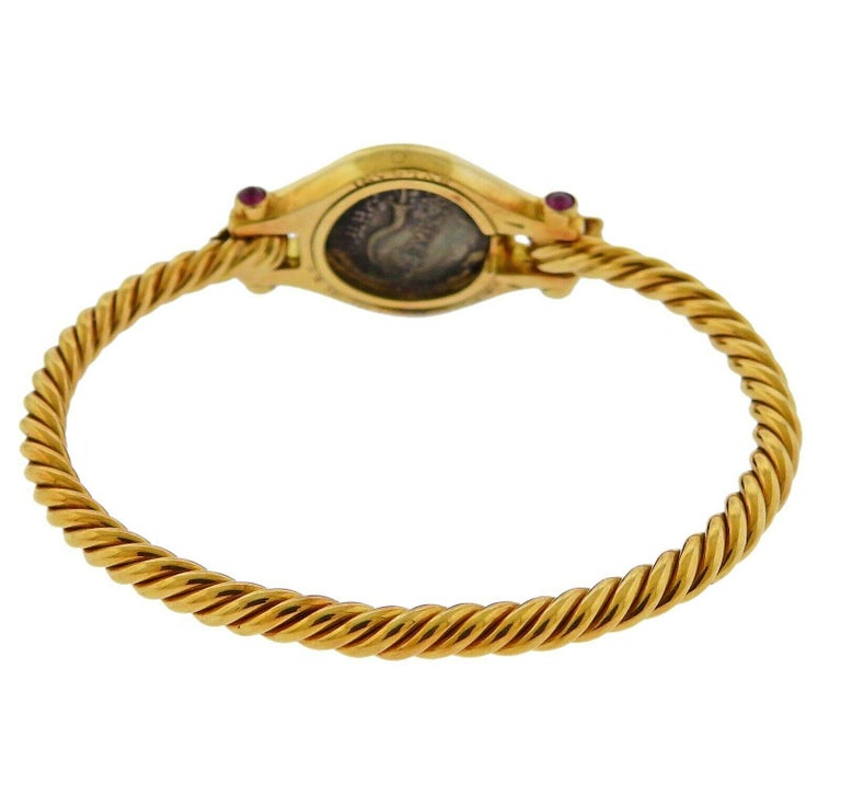 18k yellow gold bracelet by Bvlgari, set with an ancient coin, surrounded by ruby cabochons. Bracelet will fit approx. 7