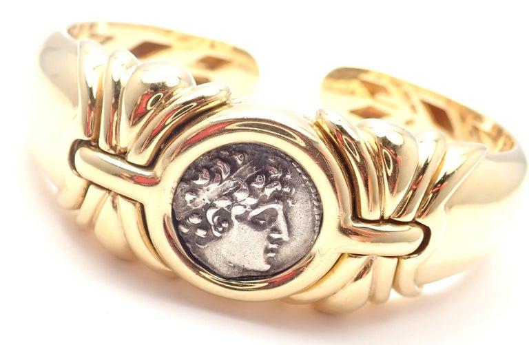 18k Yellow Gold Ancient Coin Bangle Bracelet by Bulgari.  With t1 coin Syrie Alexandre 1er 150-145 av. J.C. Details:  Length: Length 7