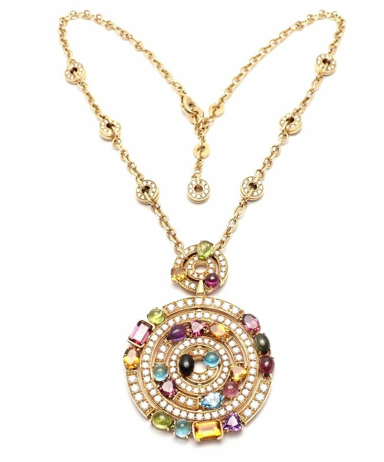18k Yellow Gold Diamond Color Stone Astrale Large Pendant Necklace by Bulgari.   With 171 round brilliant cut diamonds VVS1 clarity E color total weight approx. 5ct Blue Topazes, Amethysts, Green Tourmalines, Peridots, Citrine Quartz, Rhodolite