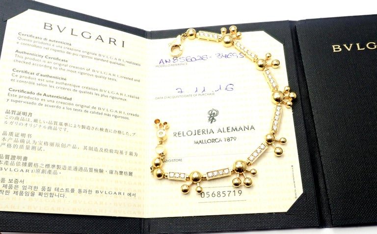 18k Yellow Gold Diamond Astrale Link Bracelet by Bulgari.  With 26 round brilliant cut diamonds color E clarity VVS-VS total weight approx. 1.50ct This bracelet comes with Bulgari certificate. Details:  Weight: 30.4 grams Length:from 7 3/4
