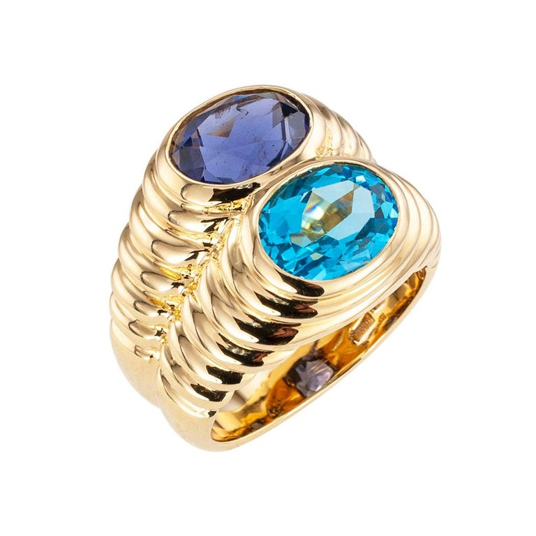 Bulgari blue topaz iolite and yellow gold double stone ring circa 1990.  Clear and concise information you want to know is listed below.  Contact us right away if you have additional questions.  We are here to connect you with beautiful and