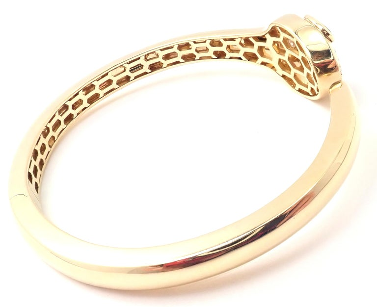 18k Yellow Gold Diamond Rubellite Serpenti Snake Bangle Bracelet by Bulgari.  With 18 round brilliant cut diamonds VS1 clarity, E color total weight approx. .30ct 2 pear shape rubellite stones. This bracelet comes with the box and