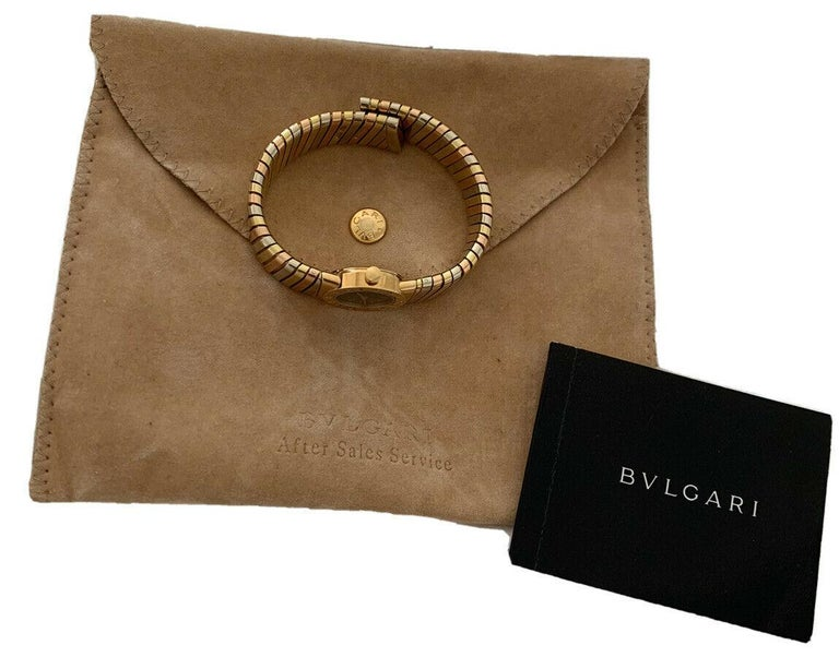 Bulgari Bvlgari Tubogas 18K White, Yellow & Rose Gold Watch BB 19 2T   Brand	Bulgari Ref #	BB 19 2T Dial         Black Case Material	18k Yellow Gold Case Size	19mm Bracelet	18k tri color gold Movement	quartz Box/ Papers    No Condition	Please refer