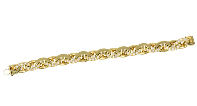 Flat anchor style polished gold links some of which are set with round brilliant cut diamonds, weighing approximately 2.10 CTW, G/H color and VS clarity  Concealed clasp with fold-over safety  Bold contemporary bracelet  Fully singed Bulgari, NY and