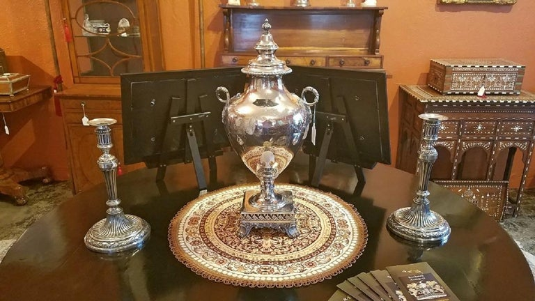 Presenting a gorgeous mid-19th century 'Old Sheffield Plated Silver' samovar with mother of pearl handle by the very highly regarded Elkington & Co, and dating from 1852.  It is fully marked on the base. The first mark signifies 'electro plate',
