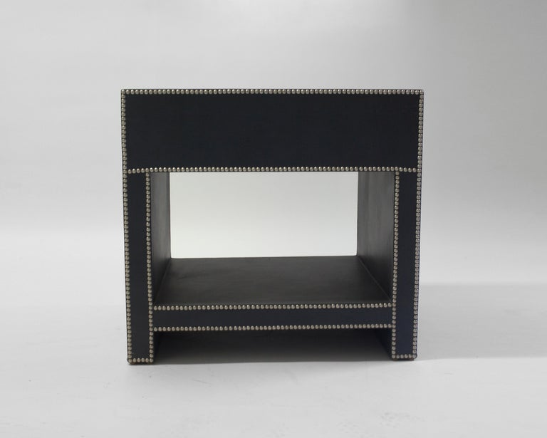 The Keap bedside table by LF upholstery shows practicality meeting style. Beautiful handcrafted wood frame with leather upholstery and shown with pewter nailhead trim. Shown with a drawer and open shelf for storage.
