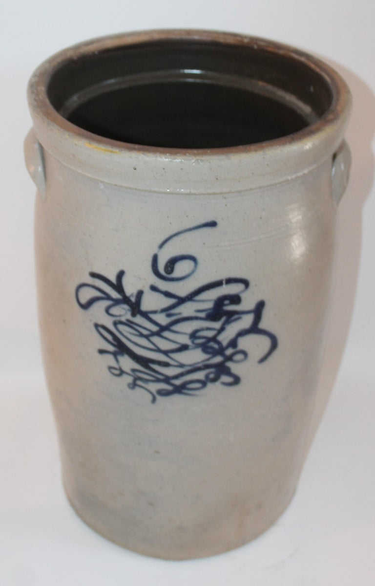 This fine butter churn has the salt glaze and blue decoration with a number six on the face of the crock. It has the doubled handles in fine condition.