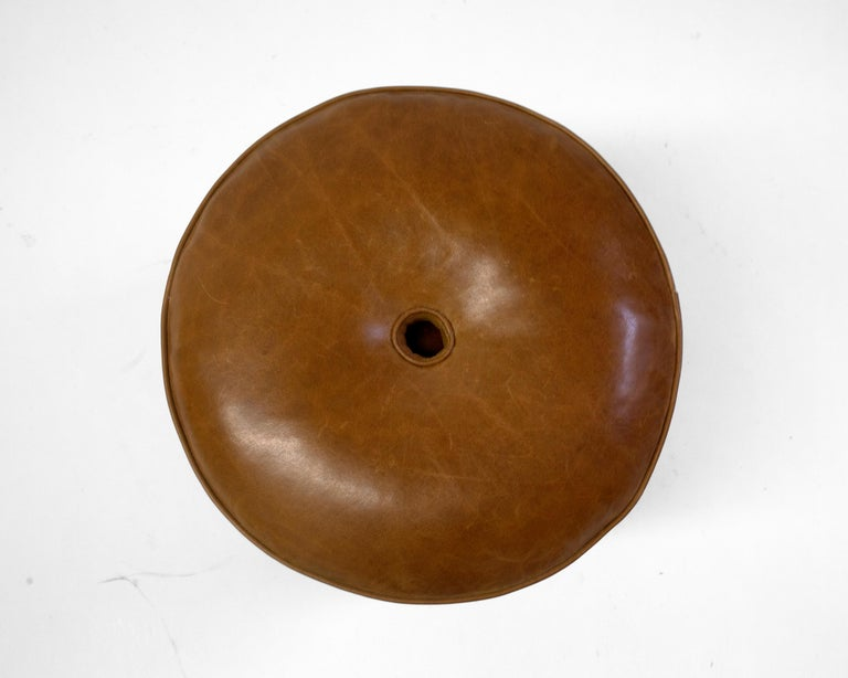new product d8306 a6798 Round Leather Pouf on Dark Mahogany Base with Circular Detail at Seat