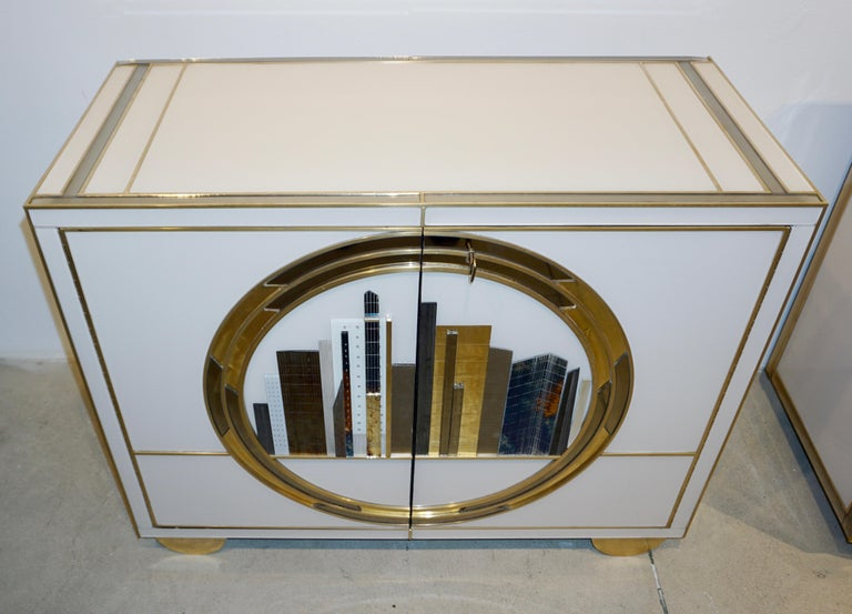 Brass Italian Contemporary Bespoke Ivory Cabinets with New York Blue & Gold Sculpture For Sale