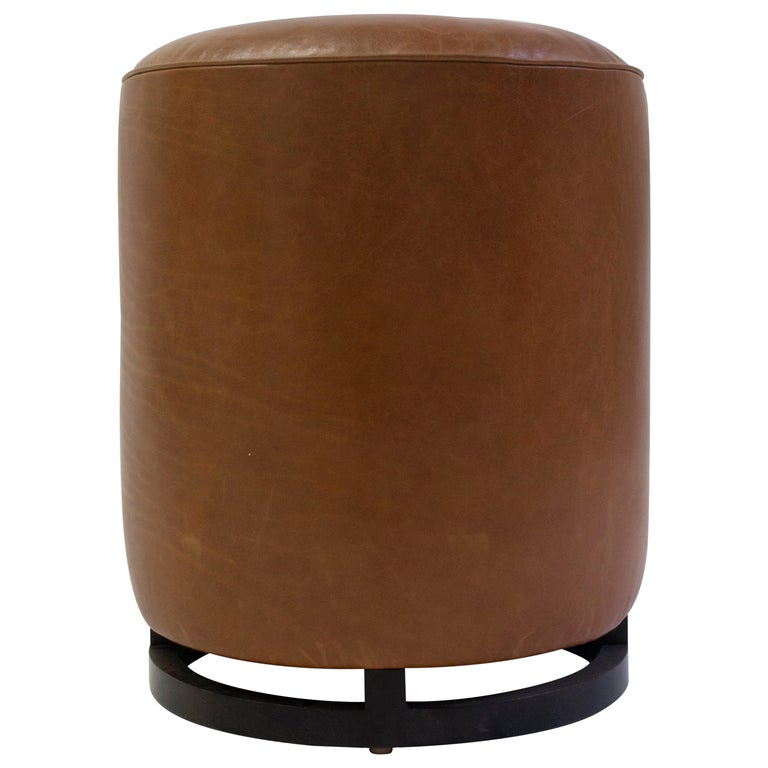 Round Leather Pouf On Dark Mahogany Base With Circular