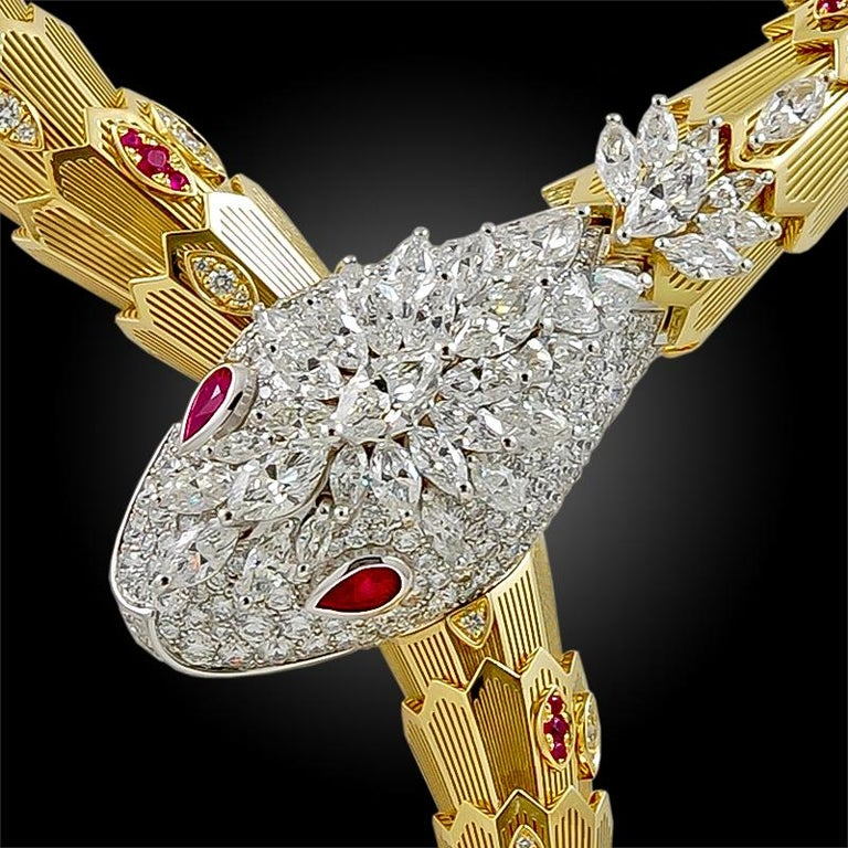 Capturing the seductive and alluring quintessence of the Bulgari Serpent, this resplendent piece sinuously curves around the neck, with scales comprised of 18k yellow and white gold, accented with several diamonds and rubies, a pavé head filled with
