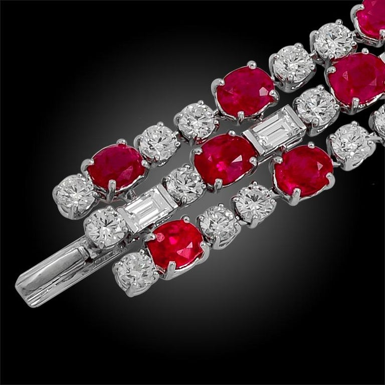 A magnificent Bulgari bracelet that dates back to the 1960s, comprised as three rows of no heat rubies from Burma, stunning pink sapphires, and radiant diamonds of brilliant luster, excellently crafted in platinum. Bulgari uses only the finest, most