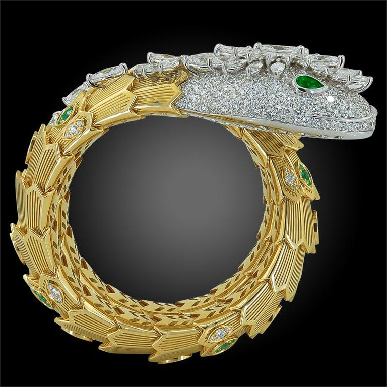 An 18k white and yellow serpenti gold bracelet, set with pave diamond weighing approx. 18.90 cts. and round and emerald weighing approx. 1.64 cts. Signed Bulgari With box and papers