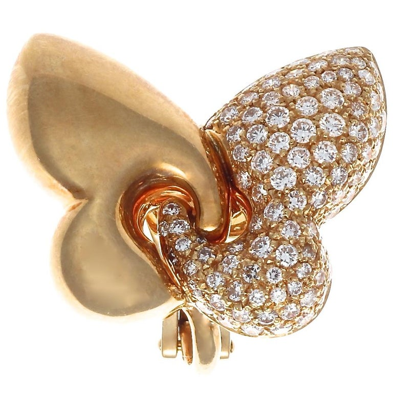 The perfect diamond and gold earrings for your daily life, by the coveted house of Bulgari. Abstract butterflies are adorned with 184 round brilliant cut diamonds, weighing approximately 1.90 carats, D-E color VVS+ clarity. Signed Bvlgari including