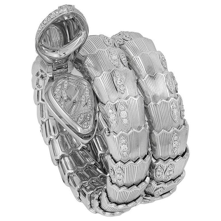 BULGARI Diamond Onyx Serpenti Watch An 18k white gold serpenti watch, set with brilliant-cut round diamonds and onyx signed BVLGARI.