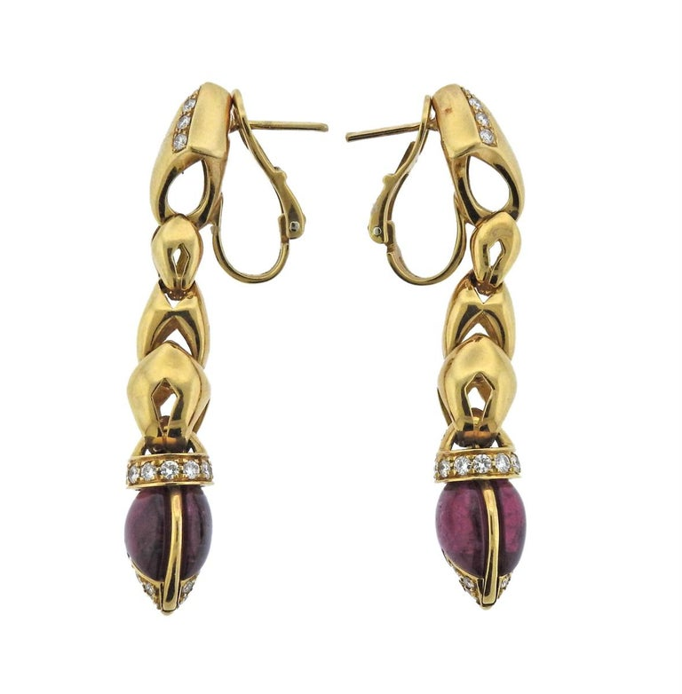 Pair of 18k gold drop earrings by Bvlgari, decorated with pink tourmaline cabochons and approx. 0.90ctw in G/VS diamonds. Earrings are 52mm long and weigh 26.3 grams. Marked: Bvlgari, 750, 2337AL, BA15130.