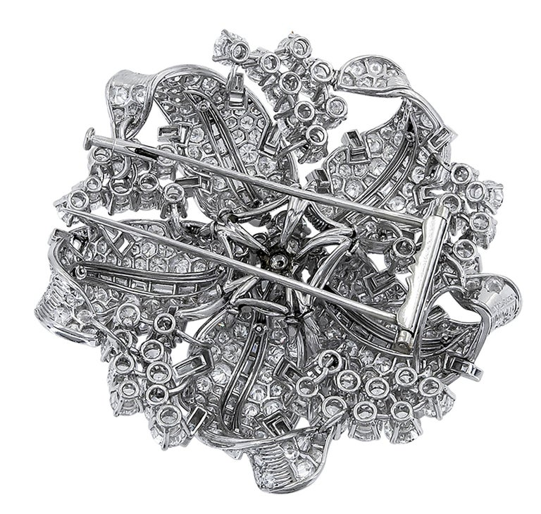 This gorgeous luxurious brooch set in the center with an old European-cut diamond weighing approximately 2.00 carats, the petals and sides set with round and baguette diamonds weighing approximately 28.50 carats.  Total weight of diamonds is