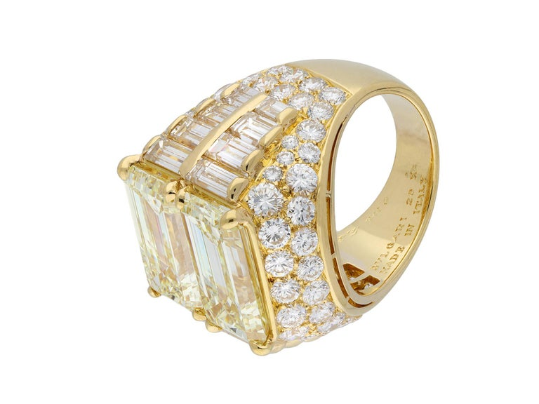 Bulgari diamond 'Trombino' ring. An important piece, set horizontally to centre with two emerald-cut diamonds in open back claw settings with an approximate combined weight of 10.16 carats, flanked by sixteen vertically set rectangular baguette cut