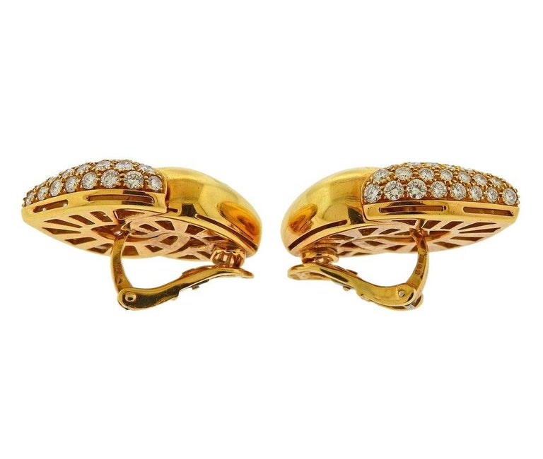 Pair of 18k yellow gold Doppio Cuore earrings, set with approx. 5.50ctw in G/VS diamonds. Earrings are 30mm x 24mm. Weight is 37.1 grams. Marked Bvlgari, 750, 2337AL.