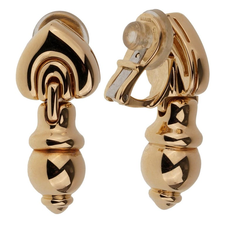 A fabulous pair of vintage Bulgari drop clip-on earrings crafted in 18k yellow gold. The earrings measure 1