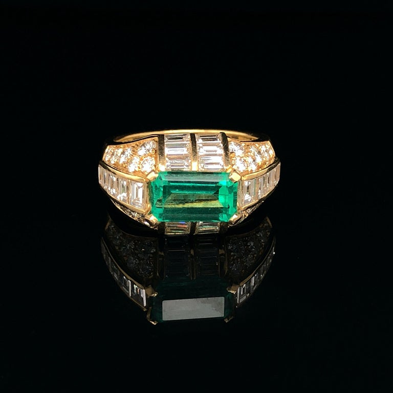 An emerald and diamond ring in yellow gold by Bulgari, ca. 1970s. The Trombino is a very popular and iconic ring model by Bulgari. The ring has a very smart and luxurious design, emphasising the centre gemstone, with the diamonds set in a manner