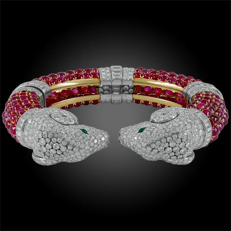 Extremely rare early 1960s Bulgari Rome cabochon ruby diamond rams heads bangle. The rams head symbolize Capricorn and strength. The rams heads finials finely detail pave-set with round diamonds and emerald eyes and having circular baguette diamond