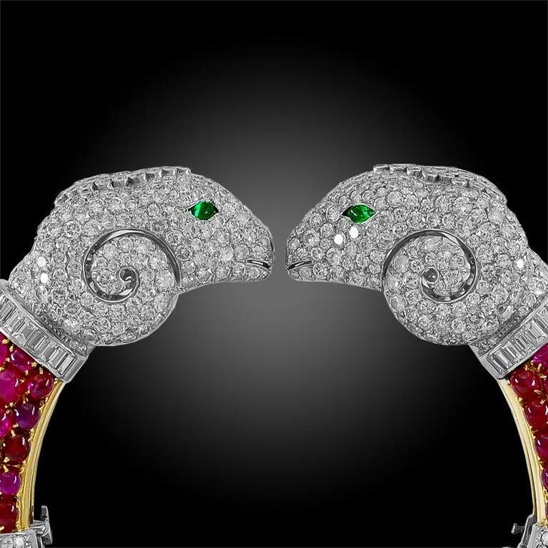 Rare 1960s Bulgari Rome Cabochon Ruby Diamond Double Ram's Head Bangle In Excellent Condition For Sale In New York, NY