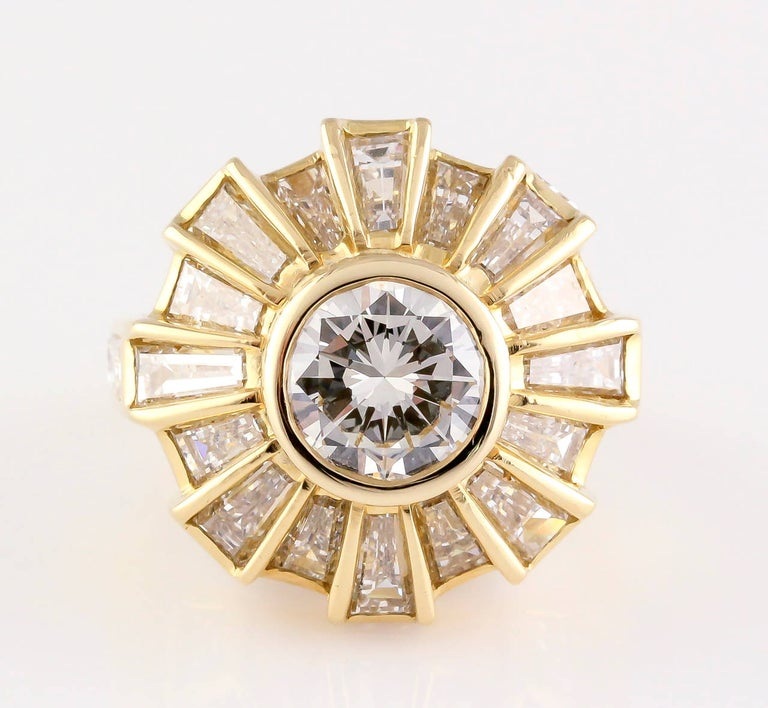 Very fine diamond and 18K yellow gold ring by Bulgari. It features very high grade round and an array of baguette cut diamonds. Central stone is approx. 1.75-2.0 cts, approx. G-H color and VS clarity, with a total combined carat weight of approx.