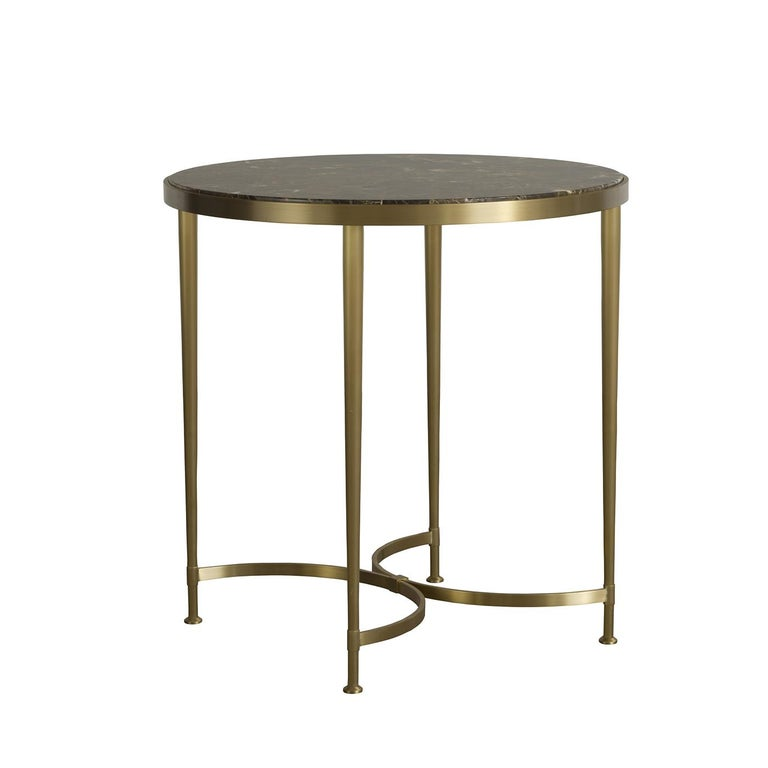 Part of the Ferrando collection, this side table can be displayed alone as an accent piece in a living room or combined with the Ferrando coffee table for a cohesive look. The brass structure, with its delicate satin finish, mixes the curves of the