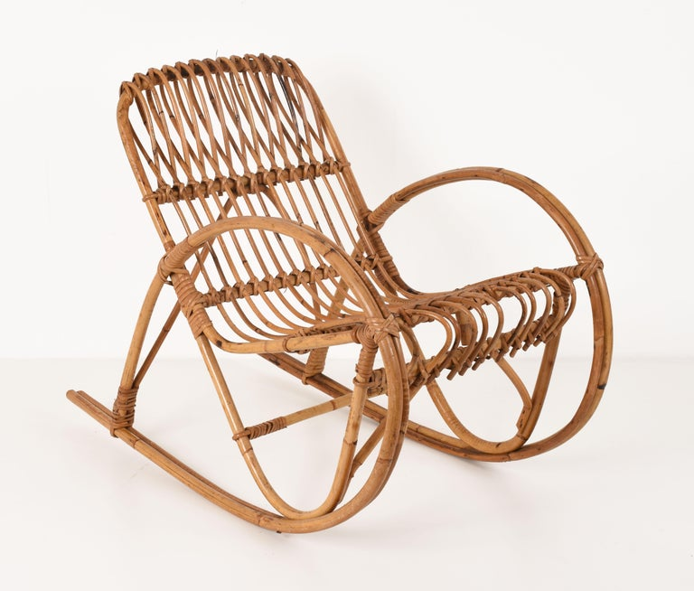 The rocking chair for children was attributed to Franco Albini and manufactured in the 1950s. The chair is in folded rattan, beautiful with beautiful details and in very good condition. Perfect for the little child. This chair is quite special