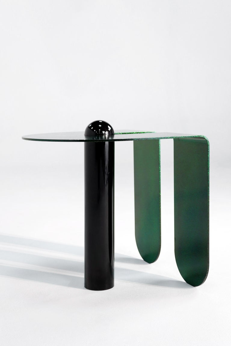 Juxtaposing highly distilled forms with sensuous curves, the U & I side table is both playful and restrained. Powder-coated with a sparkling, three-dimensional candied glaze.   All parts are connected with mechanical fasteners and can be assembled