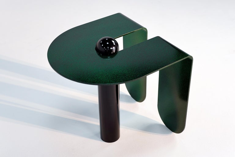 Juxtaposing highly distilled forms with sensuous curves, the U & I side table is both playful and restrained. Powder-coated with a sparkling, three-dimensional candied glaze.  Most custom colors available upon request. This listing is for a