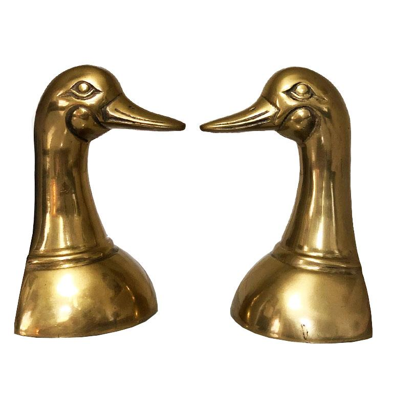 Pair of cast brass duck or mallard head book ends. Very sturdy and heavy. Great for holding up books on a bookshelf, or for decor on an entry table.