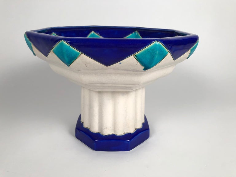 An Art Deco period ceramic footed octagonal compote, or footed bowl, by Boch Frères in blue and turquoise enamels. Signed and numbered on base, Belgian, circa 1930s. Perfect for use as a centerpiece on its own or with fruit or flowers.
