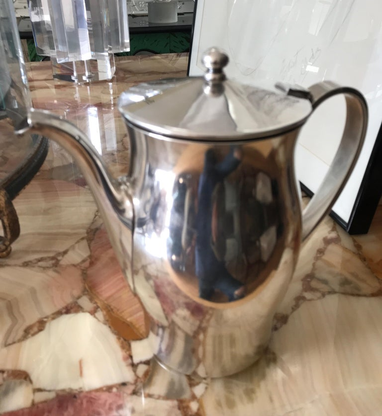 Midcentury hotel silver coffee pot.  Great quality. Fine profile. By repute from the Waldorf Astoria in New York. Would also make for a nice water pitcher. Stamped Victor S Co. to the base.