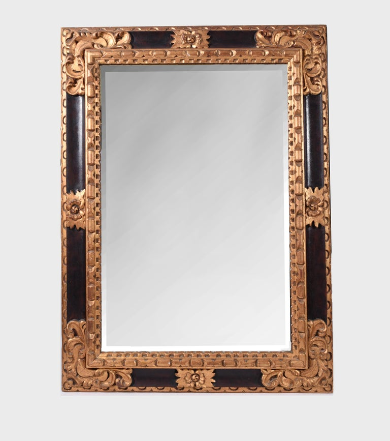 Mid-20th century giltwood framed design details hanging wall mirror. The hanging wall mirror measure about 45 inches length x 33 inches width.