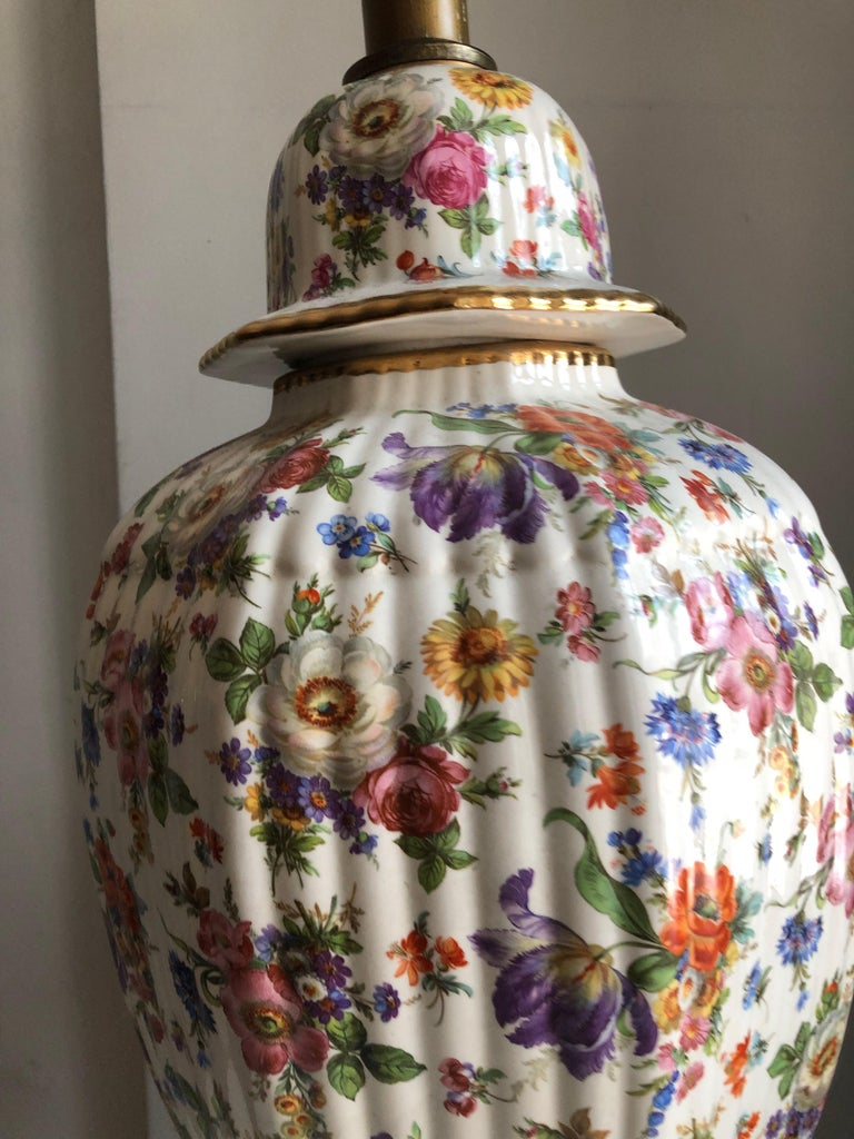 Gorgeous and monumental gilt hand painted floral Porcelain chinoiserie ginger jar wired as lamp. Lovely scale and proportions. Genius use of color.
