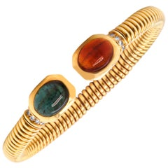 Bulgari Green and Red Oval Cabochon Tourmaline Yellow Gold and Diamond Bangle