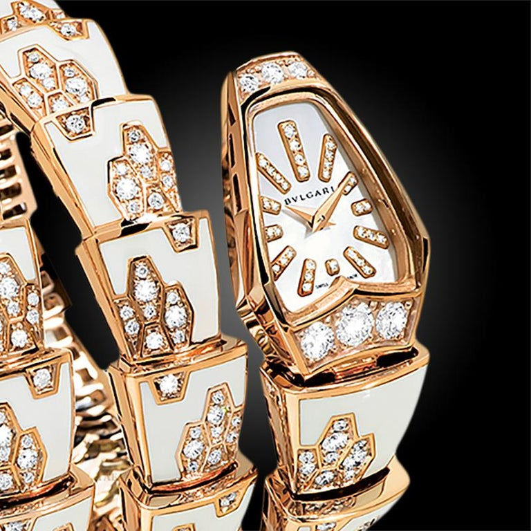 A 18K rose gold Bulgari Serpenti watch, designed as coiled serpent, the dial set with mother-of-pearl, the scales applied with enamel, set with round diamonds, quartz movement.  Signed Bulgari  Vintage and Estate Jewelry Collection