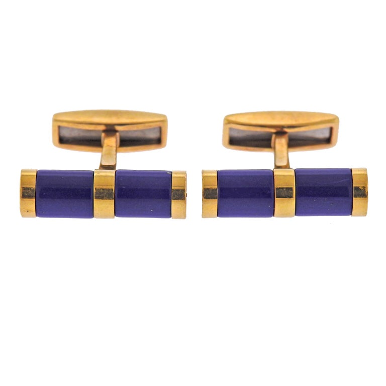 Pair of 18k gold cufflinks by Bvlgari, with lapis lazuli. Top measures 21mm x 6mm, back - 15mm x 5mm. Weight - 15.2 grams. Marked: Bvlgari, 1697AR, Italy,750.