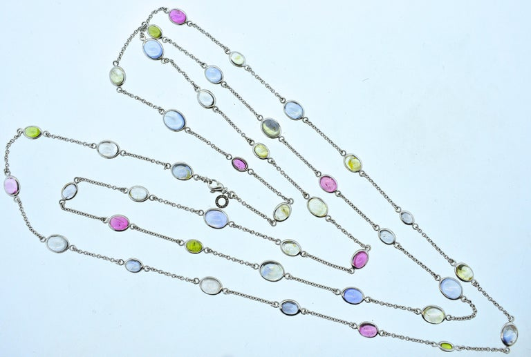 Bulgari long 18K white gold chain set with 41 sapphires of various colors, this necklace is 57 inches long and 42 grams.  This colorful necklace can be worn a variety of different lengths making this necklace quite versatile and easy to wear.  Made