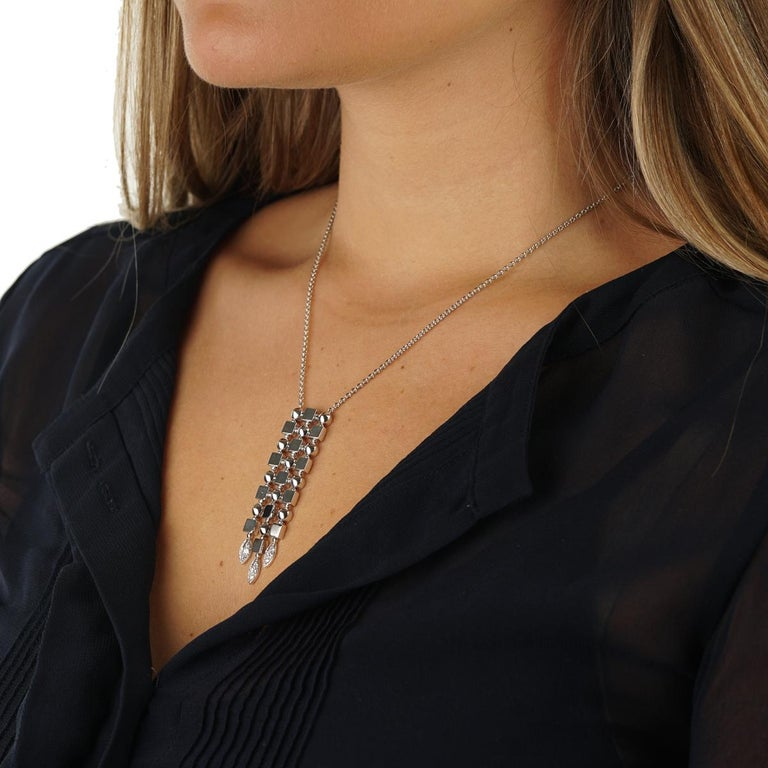 Designed to impress this authentic Bulgari Lucea necklace is adorned with the finest Bulgari Vs Quality round brilliant cut diamonds set in 18k white gold.   Dimensions: .62″ Inches wide by 2.40″ Inches in length Necklace Length: Adjustable between