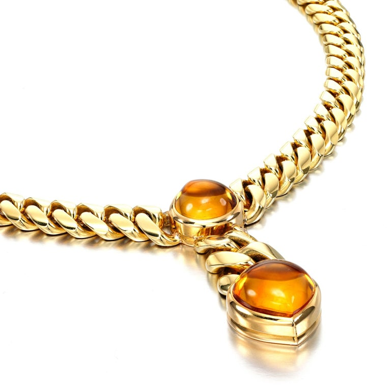 An iconic Bulgari necklace circa 1970s showcasing 2 cabochon citrines suspended by a curb style necklace. The necklace has a total weight of 112 grams.