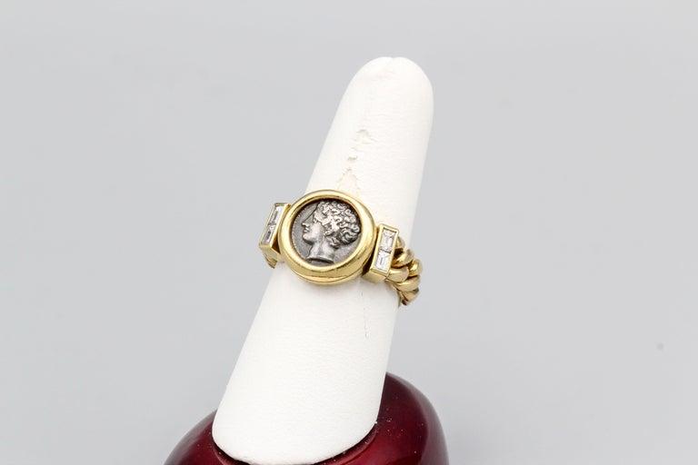 Fine diamond set ancient Roman coin and 18K yellow gold flexible ring by Bulgari, circa 1970s. It features a Roman coin dated 3rd century B.C. Diamonds are high grade baguette cut, Approx. size 7.5.  Hallmarks: Bulgari, 750, 3rd century B. C.,