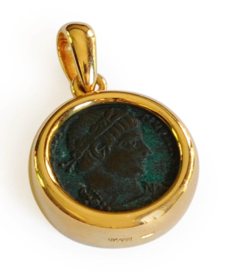 A classic Bulgari Monete piece featuring an ancient bronze Roman coin inscribed 'Rome Constantinus I Aug. A.D. 307-337' suspended from a two-color 18 karat gold braided necklace. Internal circumference 14½ inches. Made in Italy.