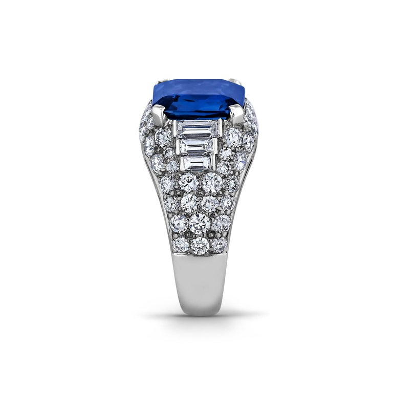 A vibrant velvety blue natural no heat certified 3.75 carat emerald cut sapphire is the striking centerpiece of this extraordinary Bulgari vintage ring.  Surrounded by a total of 1.80 carats of baguette and round brilliant cut diamonds and mounted