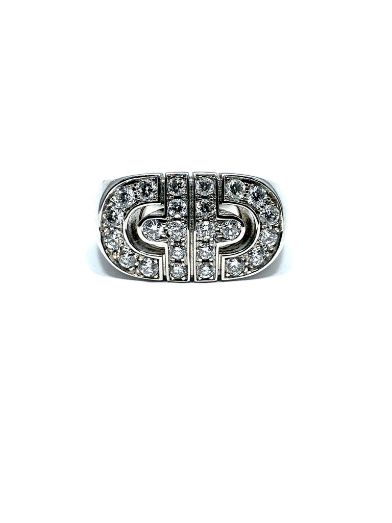 Bulgari 18K White Gold Diamond Parentesi Revolution Ring. This stunning ring is crafted of 18 karat white gold and features a Parentesi motif at the center with a total approximate carat weight of .88 carats. This is a magnificent ring with the