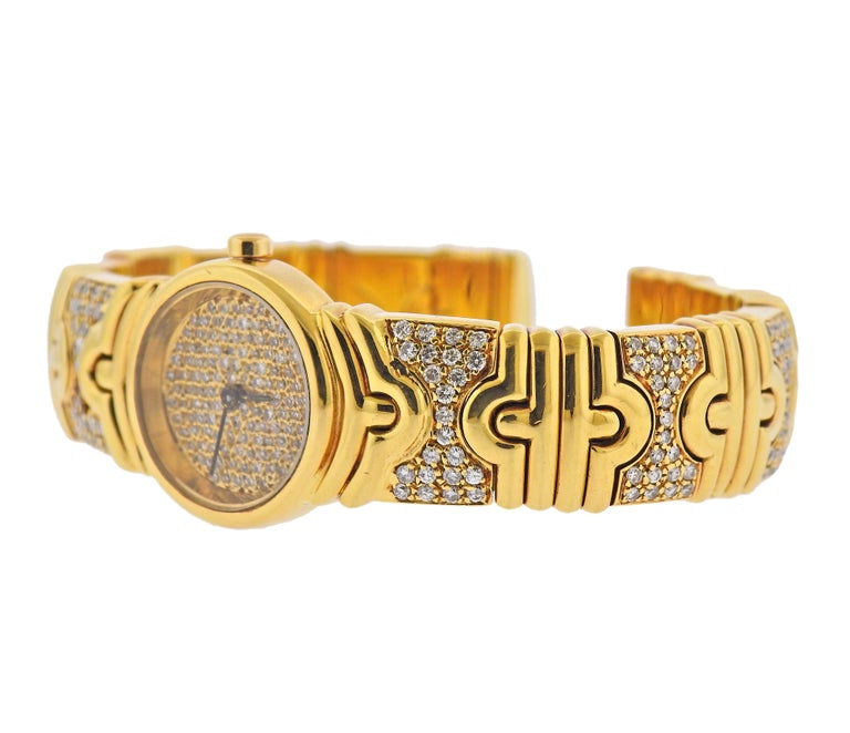 Impressive 18k gold Parents watch bracelet by Bvlgari, decorated with a total of approx. 4 carats in diamonds (one stone is missing), on bracelet and dial. Bracelet will fit approx. 6.75