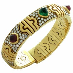 Bulgari Parentesi Sugarloaf Ruby Emerald Diamond Yellow Gold Cuff Bracelet