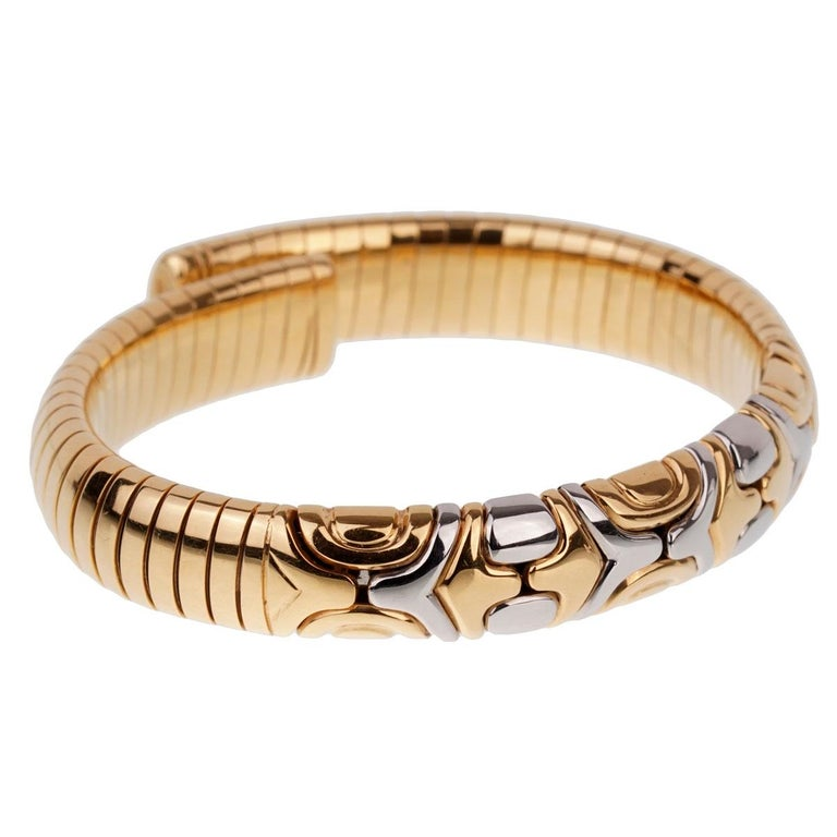 A fabulous iconic Bulgari Parentesi bracelet showcasing 18k yellow gold and stainless steel.
